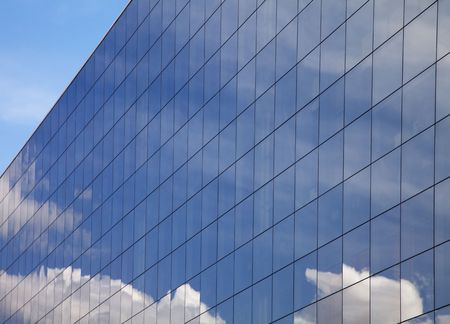 Modern office building and blue sky reflection  photo