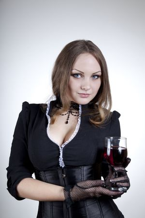 Aristocratic woman with glass of wine, studio shot  photo
