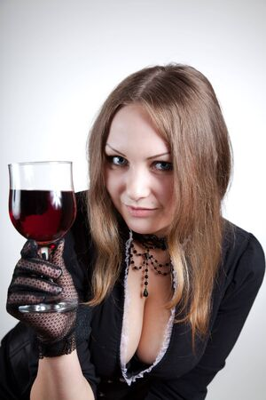 Sensual woman with glass of wine, studio shot  Stock Photo - 7169430