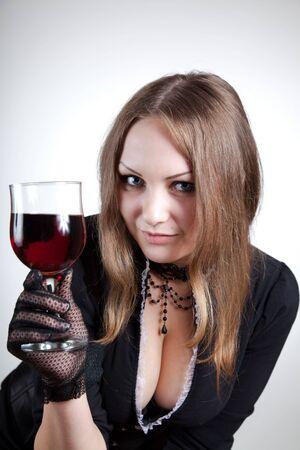 Sensual woman with glass of wine, studio shot Stock Photo - 7169430