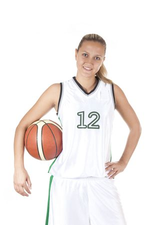 girl in shorts: Smiling female basketball player holding ball, isolated on white background