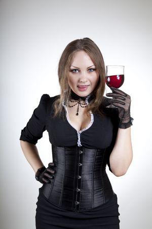 Attractive woman tasting red wine, studio shot  photo