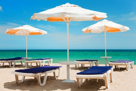 Umbrellas and chairs on beautiful tropical beach  photo