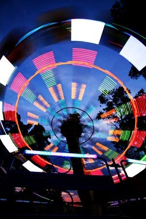 Ferris wheel in amusement park, blurred lights, night view  photo