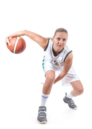 basketball shot: Female basketball player in action, isolated on white background, motion blur