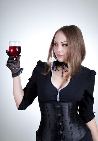 Sensual woman with glass of wine, studio shot  photo