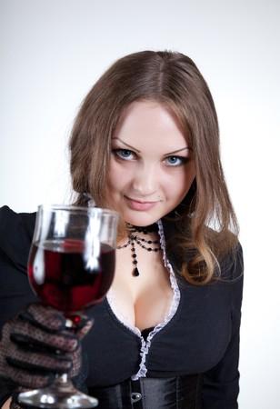 Sensual blue-eyed woman with glass of wine, studio shot  photo