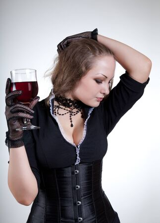 Sexy young woman with red wine, studio shot  Stock Photo - 7441451