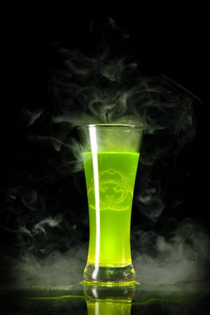 Green radioactive alcohol with biohazard symbol inside, isolated on black background  photo