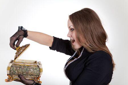Surprised woman with beautiful jewelry box, studio shot  photo