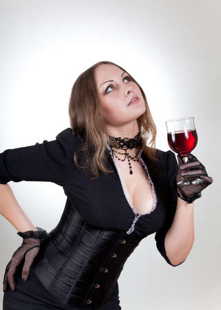 Gorgeous woman with red wine, studio shot  photo