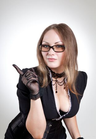 Sexy teacher in black dress and corset, studio shot  photo