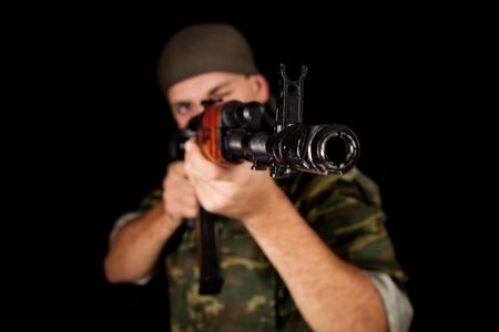 Young soldier in uniform with rifle, selective focus on weapon   Stock Photo - 7833880