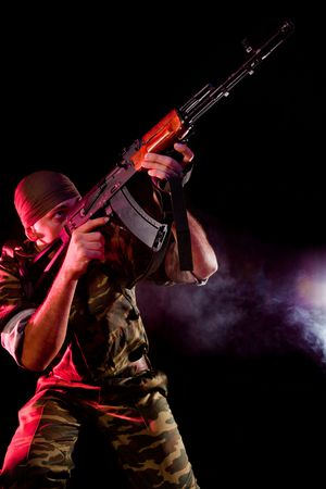 Soldier in uniform with rifle, smoky background  Stock Photo - 7833894