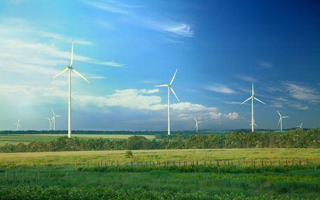 Alternative energy, wind turbines on green meadow  Stock Photo - 8174041