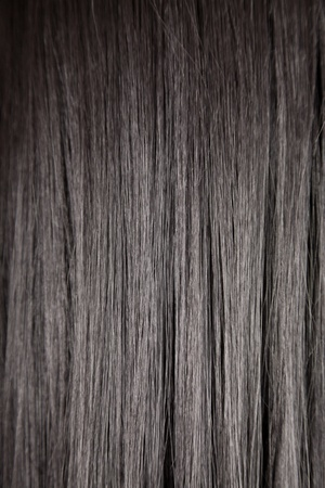 Texture of black shiny straight hair, soft focus  photo