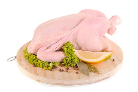 Fresh raw chicken on wooden board, isolated on white background, clipping path included  photo