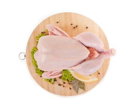 whole: Fresh raw chicken and condiments, high angle view, clipping path included