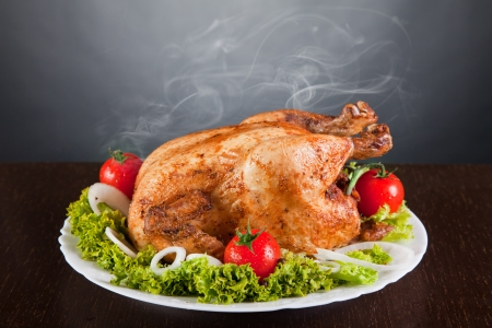 crispy: Delicious roast chicken with red tomatoes and green salad Stock Photo