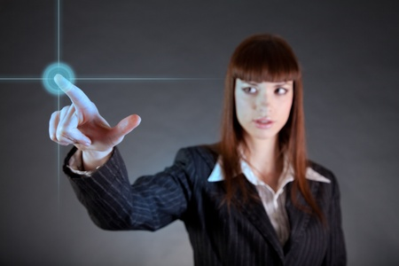 touch button: Business woman pointing on sensor screen, high technology concept