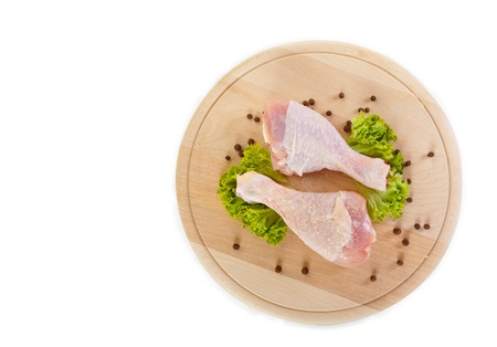 Fresh raw chicken legs with green salad, clipping path included