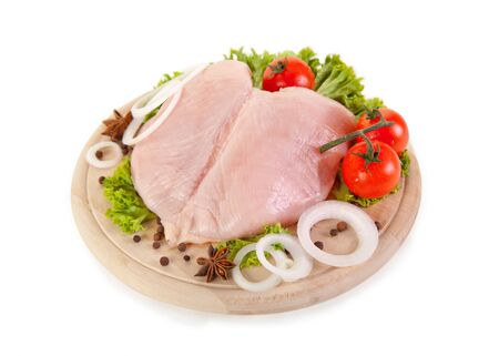 Fresh raw chicken breasts with vegetables, clipping path included