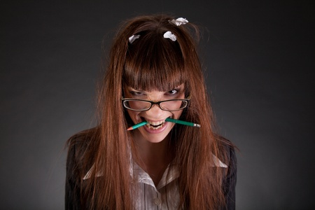 enraged: Angry businesswoman with broken pencil, studio shot