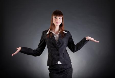 Cheerful business woman showing open hands, studio shot  photo