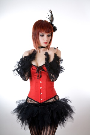 Sensual woman in red corset, studio shot over white background  photo