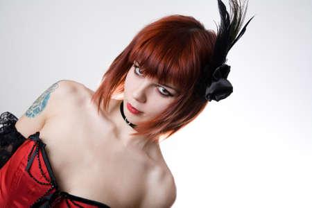 Cabaret girl with hair fascinator, studio shot on white background  photo