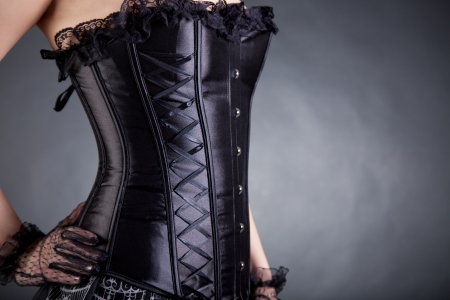 Close-up of woman in black corset, copy-space for your text Stock Photo - 10470297
