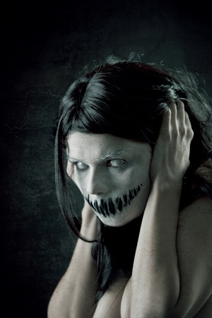 Horrible girl with scary mouth and eyes, extreme body-art  Stock Photo