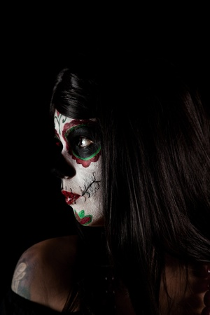 Portrait of Sugar skull girl, isolated on black background  photo