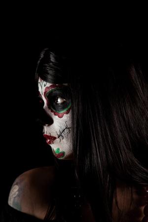 Portrait of Sugar skull girl, isolated on black background  photo