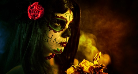 Artistic shot of sugar skull girl with dead roses, selective focus on rose