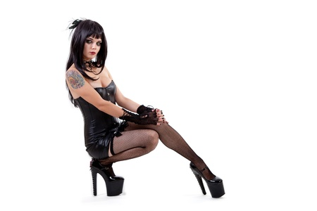 Gothic woman in sexy outfit, isolated on white background  Stock Photo - 10762851