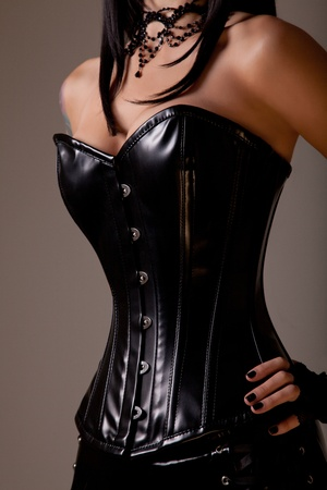 Slim sexy woman with hourglass figure in black leather corset, studio shot  Stock Photo - 11508183