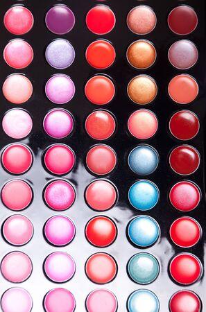 Colorful lip gloss palette, studio shot  photo