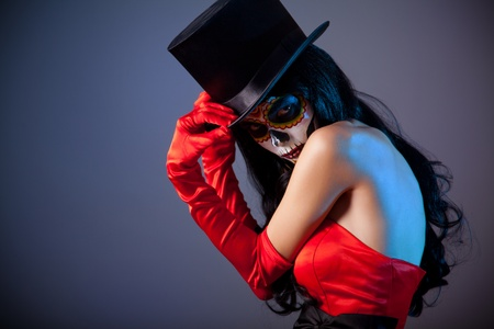 Sugar skull girl in tophat, studio shot  Stock Photo