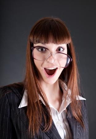 Funny businesswoman in old fashioned glasses, studio shot  photo