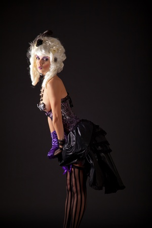 Attractive woman in burlesque outfit, studio shot  photo