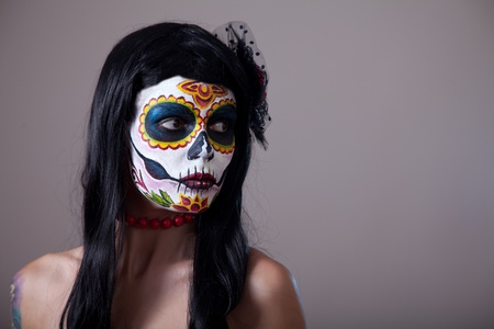 Sugar skull girl portrait, studio shot