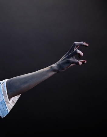 Hoog contrast zombie hand, extreme body-art, studio-opname