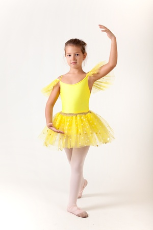 Cute little girl as ballet dancer, studio shot on white background