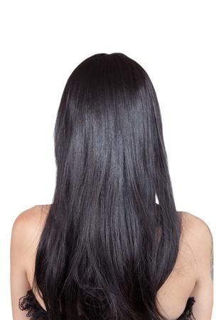 Achteraanzicht van meisje met zwart zijdeachtig haar, geïsoleerd op witte achtergrond Stockfoto