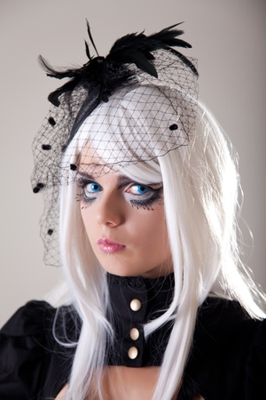 Gothic girl with creative make-up, studio shot  photo