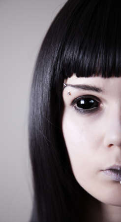 Spooky black eyed woman with pale skin, real sclera contact lenses  photo