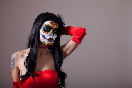 Sugar skull girl in red dress, copy-space for your text  photo