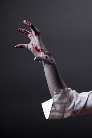 creepy hand: Creepy zombie hand, extreme body-art, studio shot  Stock Photo
