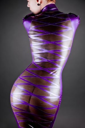 woman in transparent purple latex dress, studio shot  Stock Photo